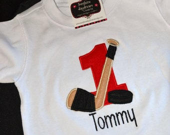 1st Birthday Shirt Hockey theme shirt number 1, hockey stick and puck  and name personalized