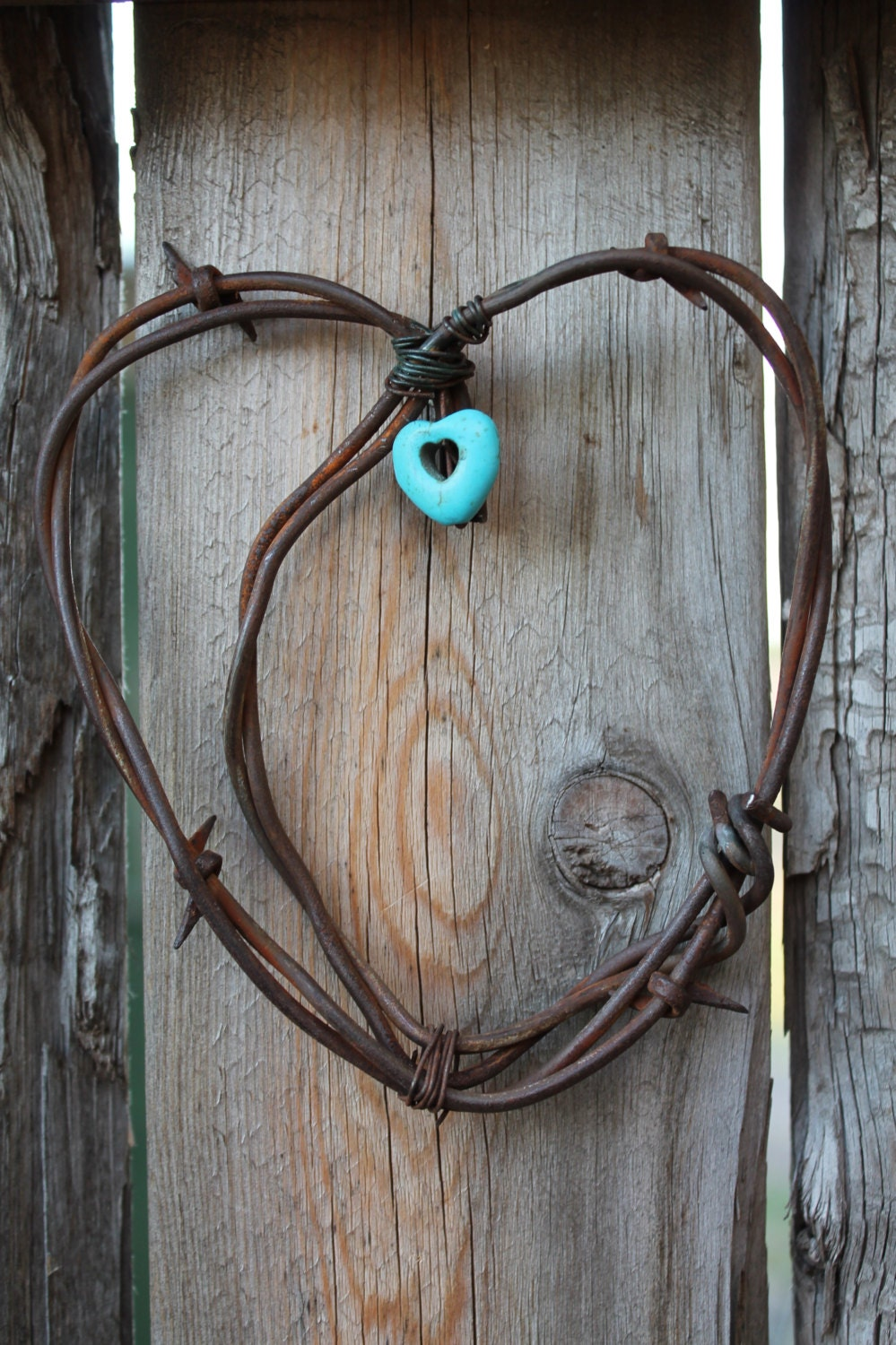 Handmade rusted barbed wire heart wall decor with turquoise