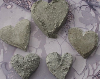 Five Sculpted Gray Concrete Hearts
