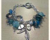 The Believe, Inspire and Fly charm bracelet.