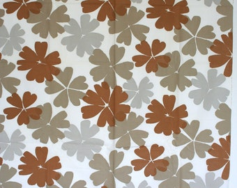 Yardage of vintage cotton fabric with large mod flowers. Tan, brown, gray.