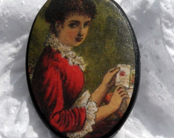 Lady in Red Cameo Brooch holding Ephemera