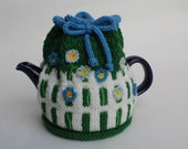 Hand Knit White Picket Fence Tea Cozy with Flower Embellishments