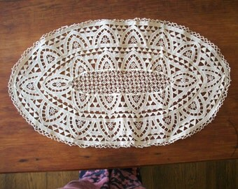 one Hand done 19th century Antique oval doily