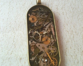 Antiqued Brass Long Oval Clockwork Clutter Necklace