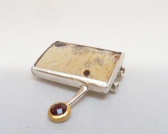 Jasper and faceted garnet brooch by CARLOS TELLECHEA