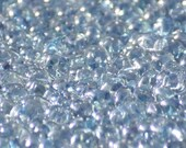 10 grams of 2,5 mm x 5,0 mm sized Luster - Transparent Blue SuperDuo two hole beads (SD005)