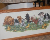 COMPLETED AND FRAMED - A Row of Puppies