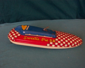Sweetie Pie 55 - old vintage metal wind up toy motor boat - made in USA