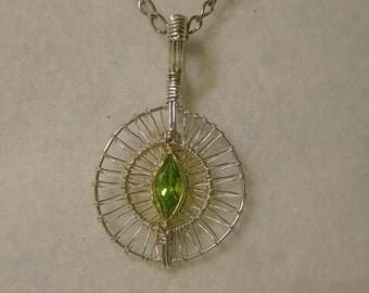 Peridot eye pendant