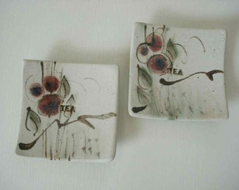 Tea bag holders (2) by Rich Agness, cream background with plum, black and sage green matte glaze