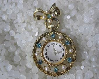 vintage brooch ice blue rhinestone old fashion pocket watch shape