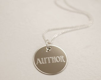 "Author --- engraved .75"" metal charm necklace"