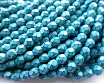 100 Czech Glass Fire Polish  in  a Turquoise Blue Snake Skin Beads in size 4mm Round