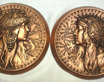 Alphonse Mucha style art nouveau  wall hanging plaques,  finished in  silver/cream or bronze