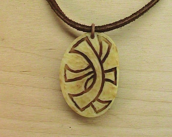 Carved Tagua-Nut Pendant on Brown Leather Cord