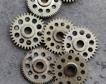 Vintage clock brass gears -- set of 8 -- D7