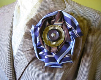 Fabric blossom and button broach