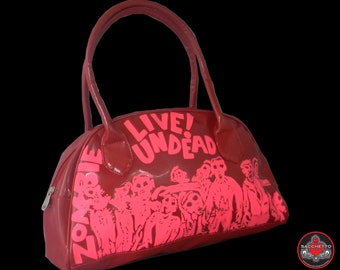 Zombies attack hot pink on red handbag