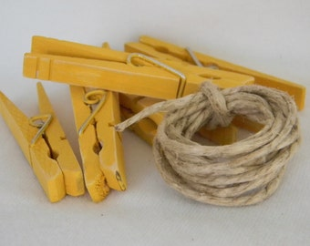 Altered set of clothespins in Turner's yellow shabby chic inspired