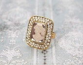 Ring repurposed vintage. Gold tone and adjustable.  Beautiful and one of a kind.