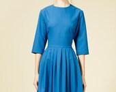 Aquamarine blue woolen dress with red detachable collar by Mrs Pomeranz