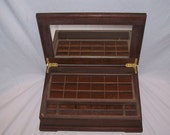 From the Prestige Collection comes the Walnut Jewelry Box with Mirror  under lid 15''x10 1/4''x5''