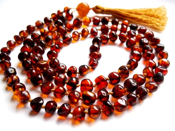Buddhist prayer beads.  Mala (108 beads) Yoga  Meditation Mala. Real Baltic Amber beads  Hand knotted.