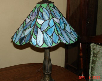 stained glass lamp in blues greens and purple