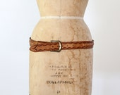 vintage tooled leather belt with western buckle