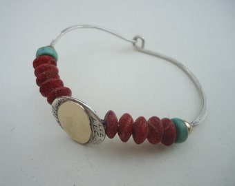 Gold and silver bracelet with turquoise and coral stones