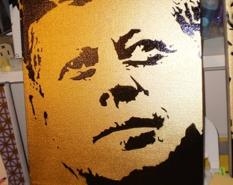 JFK (gold)