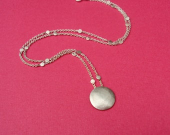 Hammered disc necklace with glittering dots