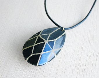 Geometric necklace faceted black gem and leather cord