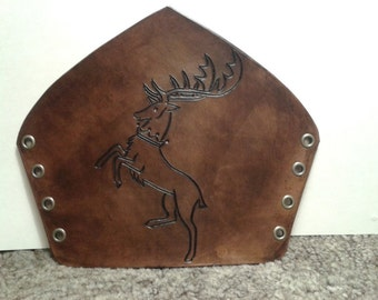 Antique brown leather bracer with hand carved Baratheon sigil from game of thrones, GOT