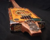 Cigar Box Guitar, Antique La Palina box 4 string, open G,  Fretless solid oak neck.