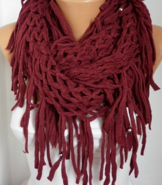 This infinity circle scarf is knit out of % cotton yarn in a burgundy color and features a brown leather patch that is debossed with the Love Your Melon logo. Made in the USA, machine washable, durable.