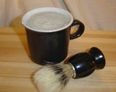 Mug of handmade tallow shaving soap with a NIP brush vintage Noritake Primastone small black mug