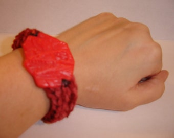 dinosaur skull toy token accent crochet bracelet bangle cuff dinosaur fossil hipster upcycled toy fun red