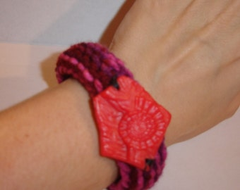 spiral shell Nautilus toy token accent crochet bracelet bangle cuff dinosaur fossil hipster upcycled toy fun red dark pink
