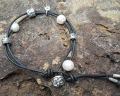 Sterling Silver and Black Leather Lariat Style Charm Bracelet