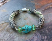 Sterling Silver Viking weave vintage style bracelet with crystals and  a turqouise nugget