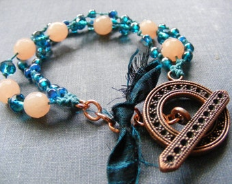 Taste of Summer Triple Strand Bracelet:  Hand knotted Shades of Teal Glass and Apricot Jade and Copper