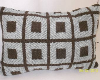 Comfort  pillow. Just the right size to rest your head on  in a car or on a plane.  Soft Terrycloth of brown with taupe background.