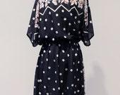 Polka dot floral zig zag pattern vintage dress with buttoned shoulder