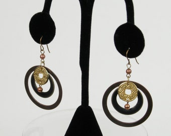 Vintage Futuristic / Sci Fi Circle & Coin Dangle Earrings In Goldtones and Copper Metallic Shades circa 1970s
