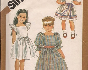 1986 Sewing Pattern Simplicity 7429 girls pullover dress size 14