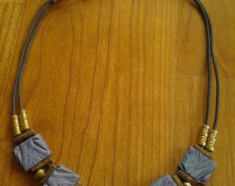 1980s blue stone and goldtone geometric necklace