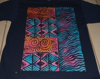 Original discharged block print on a man's XL t-shirt,abstract design with spirals, wavy lines,and diamonds, procion dyes added