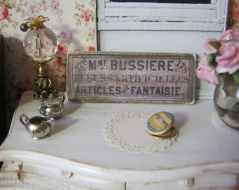 Bussiere Sign for Dollhouse